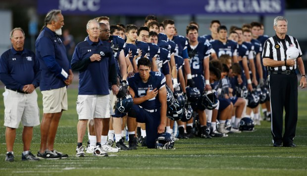 A small group of Bellarmine football players, including Jonathan Hale (52), kneel for the national anthem as Bellarmine prepares to play Junipero Serra at San Jose City College on Friday, Sept. 29, 2017, in San Jose, Calif. (Jim Gensheimer/Bay Area News Group)