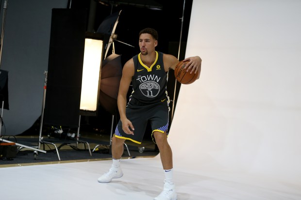 Golden State Warriors' Klay Thompson dribbles while posing for a photograph during the team's media day at their practice facility in Oakland, Calif., on Friday, Sept. 22, 2107. (Anda Chu/Bay Area News Group)