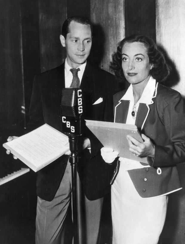 circa 1937: Joan Crawford (1908 - 1977) and her husband Franchot Tone (1905 - 1968) recording a radio show for CBS. (Photo by General Photographic Agency/Getty Images)