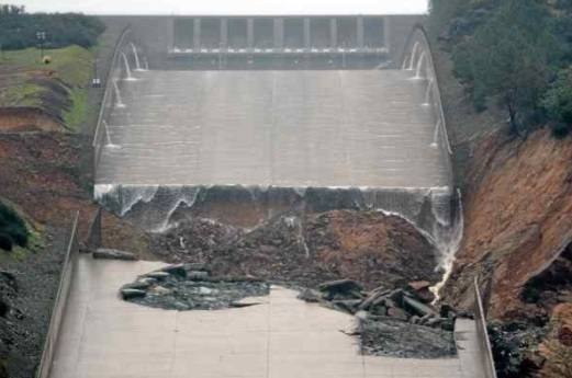 Photo from Feb. 9 shows how the hole in the damaged main Oroville Dam spillway enlarged after a 20,000 cubic-foot-per-second test release Feb. 8. Once the chute floor had broken open, the water was able to flow under additional concrete slabs and break them off as well. (Bill Husa — Mercury-Register file photo)