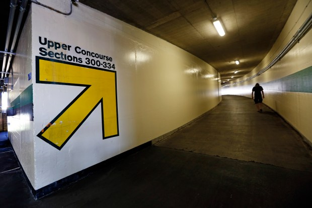 An A's fan walks up the tunnel to the upper concourse during the last home A's game of the season at the Oakland-Alameda Coliseum in Oakland Calif., on Wednesday, Sept. 27, 2017. (Laura A. Oda/Bay Area News Group)