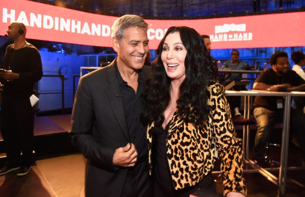 UNIVERSAL CITY, CA - SEPTEMBER 12: In this handout photo provided by Hand in Hand, George Clooney and Cher attend Hand in Hand: A Benefit for Hurricane Relief at Universal Studios AMC on September 12, 2017 in Universal City, California. (Photo by Kevin Mazur/Hand in Hand/Getty Images)