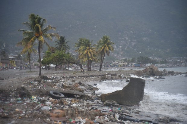 Debris and trash is seen on a beach in Cap-Haitien on September 7, 2017, as Hurricane Irma approaches. Irma was packing maximum sustained winds of up to 185 mph (295 kph) as it followed a projected path that would see it hit the northern edges of the Dominican Republic and Haiti on Thursday, continuing past eastern Cuba before veering north for Florida. / AFP PHOTO / HECTOR RETAMAL (Photo credit should read HECTOR RETAMAL/AFP/Getty Images)