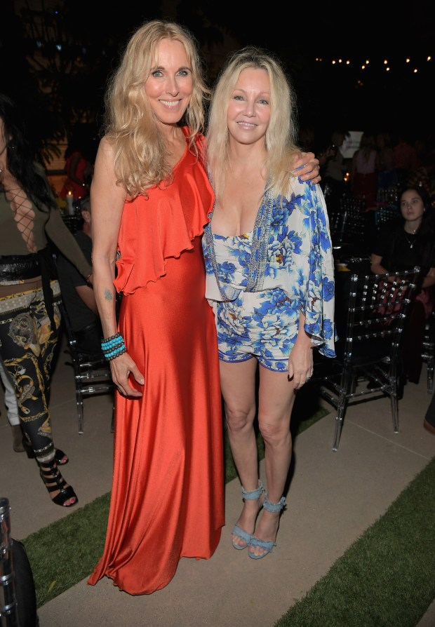 """LOS ANGELES, CA - SEPTEMBER 09: Farrah Fawcett Foundation President and CEO, Alana Stewart (L) and Heather Locklear at the Farrah Fawcett Foundation's """"Tex-Mex Fiesta"""" 2017 at Wallis Annenberg Center for the Performing Arts on September 9, 2017 in Los Angeles, California. (Photo by Charley Gallay/Getty Images for the Farrah Fawcett Foundation)"""