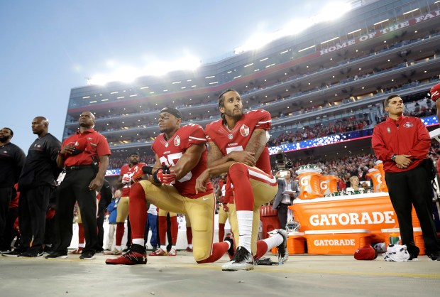 With so many players and teams kneeling during the national anthem these days, it's created a lot of extra work for sportswriters. Strangely, the man who started it all, Colin Kaepernick, still can't get a job in the NFL. (AP Photo/Marcio Jose Sanchez, File)