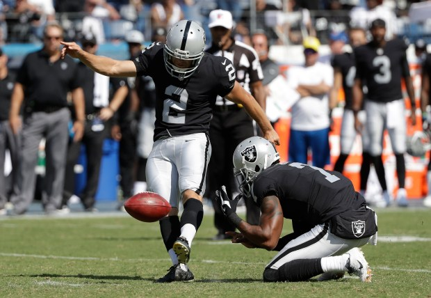 Oakland Raiders kicker Giorgio Tavecchio (2) kicks a 43-yard field goal as Marquette King (7) holds against the Tennessee Titans in the second half of an NFL football game Sunday, Sept. 10, 2017, in Nashville, Tenn. (AP Photo/James Kenney)