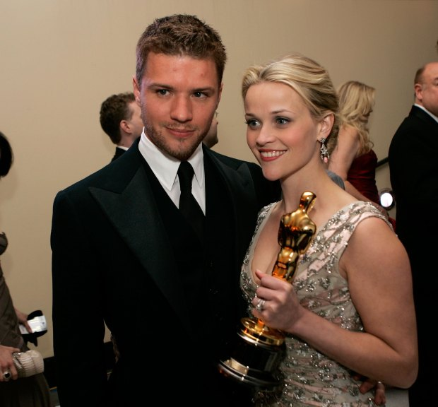 HOLLYWOOD - MARCH 05: Actress and winner Reese Witherspoon poses with her Oscar and husband Ryan Phillippe (L) as they attend the Governor's Ball after the 78th Annual Academy Awards at The Highlands on March 5, 2006 in Hollywood, California. (Photo by Kevin Winter/Getty Images)