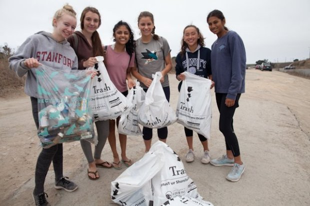 California Coastal Cleanup Day volunteers, from left, Christine Burchinal, 16, Emily Wilcox, 16, Natasha Aji, 16, Natalia Feinberg, 16, Hannah Delaney, 15, and Bridgette Castelino, 15, all members of the Student Environmental Action Society at Presentation High School in San Jose, are photographed holding bags of trash at Bonny Doon Beach south of Davenport, Calif., on Saturday, Sept. 16, 2017. (Ethan Baron/Bay Area News Group)