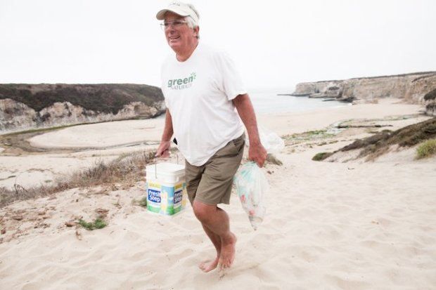 Rich Pasco, 67, of San Jose carries bags of trash up from Bonny Doon Beach on California Coastal Cleanup Day on Sept. 16, 2017. (Ethan Baron/Bay Area News Group)