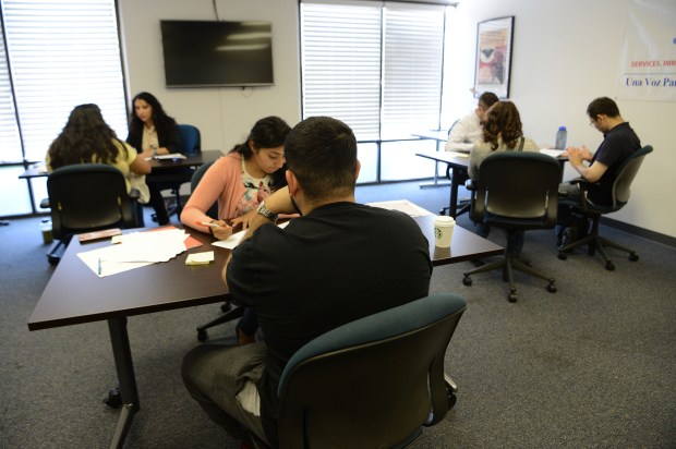 Clients work with staff to fill out necessary paperwork at the offices of SIREN in San Jose, Calif., on Wednesday, Sept. 13, 2017. Current Deferred Action for Childhood Arrivals, or DACA, recipients have a deadline of October 5 to submit their applications for renewal. With DACA set to be phased out over the next months, there is a rush to protect their status before the deadline. (Dan Honda/Bay Area News Group)