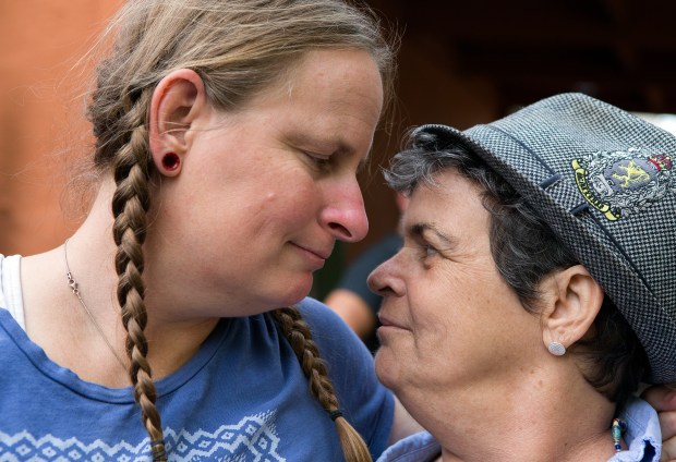 Tamara Thompson, left, and Jil Finnegan share a moment together during Finnegan's farewell party at her home in Oakland, California on Saturday, September 16, 2017. Finnegan, who has cancer, has opted to die under California's right-to-die law on her wedding anniversary. The party also served to celebrate the birthday of her husband Geoff Protz. (LiPo Ching/Bay Area News Group)