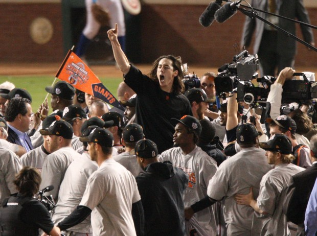 San Francisco Giants team lifts up winning pitcher Tim Lincecum as they celebrate a win 3-1 against the Texas Rangers in the final game of the World Series at Rangers Ballpark in Arlington, Texas on Monday, Nov. 1, 2010. (Josie Lepe/Bay Area News Group Archives)