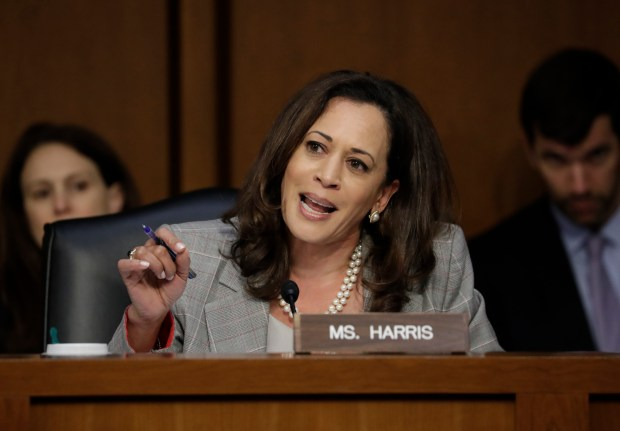 Sen. Kamala Harris, D-Calif., questions Attorney General Jeff Sessions testifies before the Senate Select Committee on Intelligence about his role in the firing of FBI Director James Comey and the investigation into contacts between Trump campaign associates and Russia, on Capitol Hill in Washington, Tuesday, June 13, 2017. (AP Photo/J. Scott Applewhite)