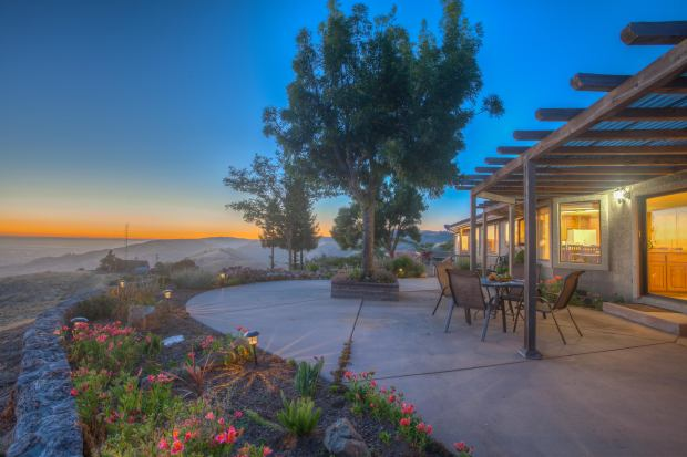 High atop a prominent South Bay ridge sits an exceptional estate showcasing spectacular views.