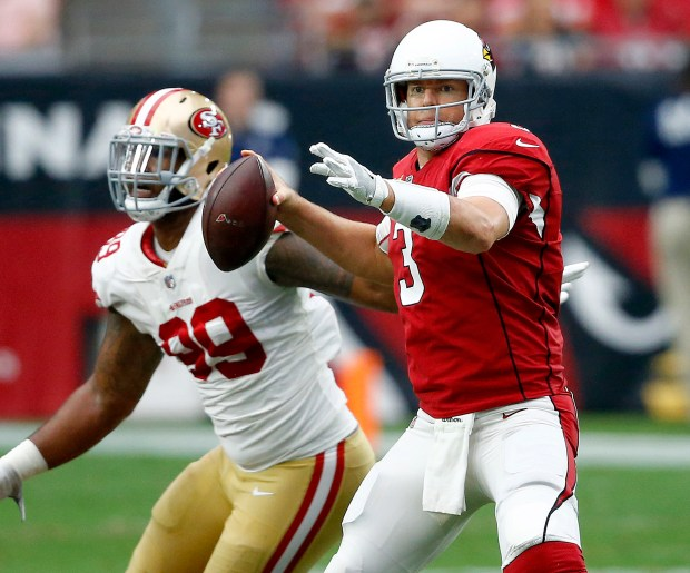 Arizona Cardinals quarterback Carson Palmer (3) looks to throw as San Francisco 49ers defensive tackle DeForest Buckner (99) pursues during the first half of an NFL football game, Sunday, Oct. 1, 2017, in Glendale, Ariz. (AP Photo/Ross D. Franklin)