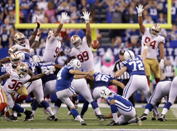 Indianapolis Colts' Adam Vinatieri (4) kicks a game winning 51-yard field goal out of the hold of Rigoberto Sanchez (2) during overtime of an NFL football game against the San Francisco 49ers, Sunday, Oct. 8, 2017, in Indianapolis. Indianapolis won 26-23. (AP Photo/Darron Cummings)