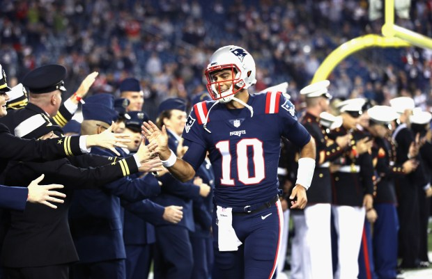Jimmy Garoppolo #10 of the New England Patriots high fives members of the military before a game against the Atlanta Falcons at Gillette Stadium on October 22, 2017 in Foxboro, Massachusetts. (Photo by Maddie Meyer/Getty Images)