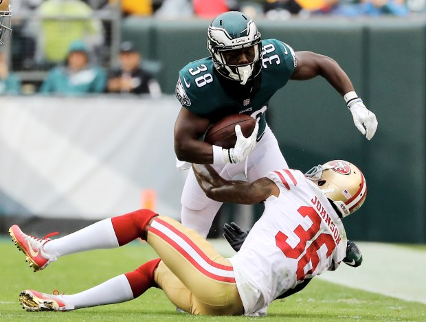 PHILADELPHIA, PA - OCTOBER 29: Kenjon Barner #38 of the Philadelphia Eagles carries the ball as Dontae Johnson #36 of the San Francisco 49ers defends on October 29, 2017 at Lincoln Financial Field in Philadelphia, Pennsylvania. (Photo by Elsa/Getty Images)