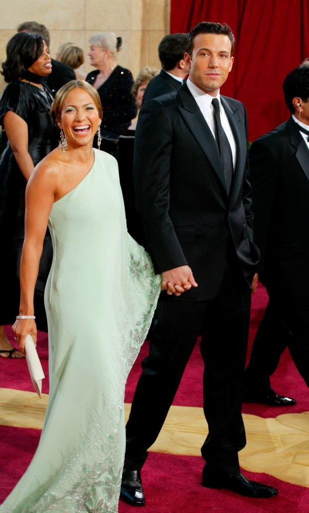HOLLYWOOD - MARCH 23: Actors Ben Affleck and fiancee Jennifer Lopez, wearing Harry Winston jewelry, attends the 75th Annual Academy Awards at the Kodak Theater on March 23, 2003 in Hollywood, California. (Photo by Kevin Winter/Getty Images)