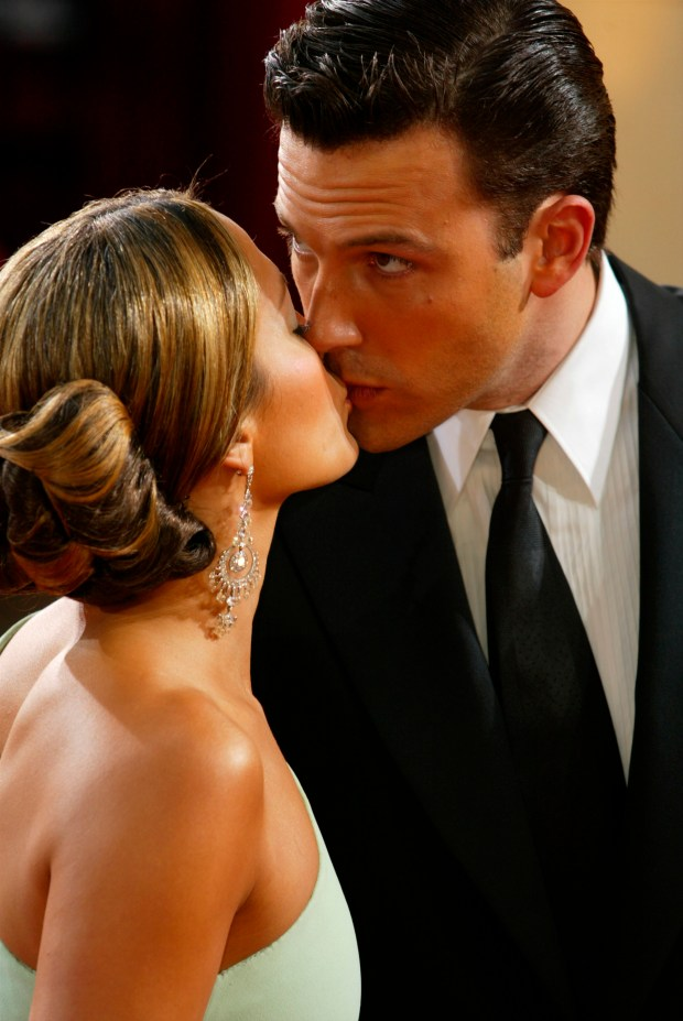 HOLLYWOOD - MARCH 23: Actor Ben Affleck kisses fiancee, actress Jennifer Lopez, wearing Harry Winston jewelry, at the 75th Annual Academy Awards at the Kodak Theater on March 23, 2003 in Hollywood, California. (Photo by Kevin Winter/Getty Images)