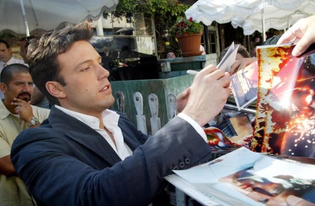 Ben Affleck signing autographs.