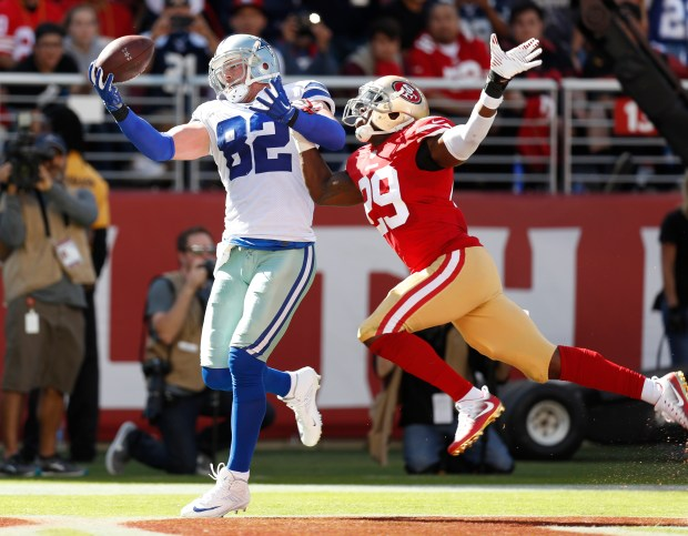 Dallas Cowboys' Jason Witten (82) makes a catch for a touchdown against San Francisco 49ers' Jaquiski Tartt (29) in the second quarter of their NFL game at Levi's Stadium in Santa Clara, Calif. on Sunday, Oct. 22, 2017. (Nhat V. Meyer/Bay Area News Group)