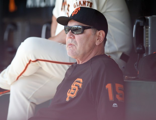 San Francisco Giants manager Bruce Bochy sits in the dugout during their game against the San Diego Padres in the fourth inning at AT&T Park in San Francisco, Calif., on Sunday, October 1, 2017. (Nhat V. Meyer/Bay Area News Group)