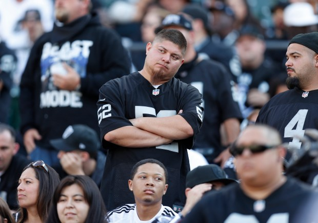 An Oakland Raiders fan watches the final seconds of the Raiders game against the Los Angeles Chargers in the fourth quarter of their NFL game at the Coliseum in Oakland, Calif. on Sunday, Oct. 15, 2017. (Nhat V. Meyer/Bay Area News Group)