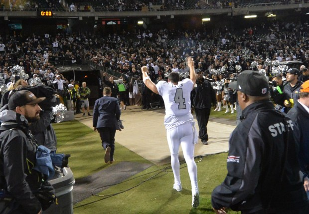 Oakland Raiders quarterback Derek Carr (4) runs off the field after the Raiders won their NFL game against the Kansas City Chiefs 30-31 at the Coliseum in Oakland, Calif. on Thursday, Oct. 19, 2017. (Doug Duran/Bay Area News Group)
