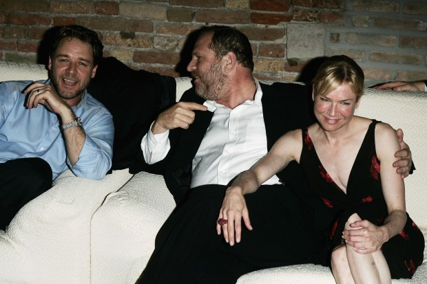 "VENICE, ITALY - SEPTEMBER 05: (L to R) Actor Russell Crowe, producer Harvey Weinstein and actress Renee Zellweger attend the after party for ""Cinderella Man"" held at the ""I Granai"" in the Hotel Cipriani on the sixth day of the 62nd Venice Film Festival on September 5, 2005 in Venice, Italy. (Photo by Pascal Le Segretain/Getty Images for Buena Vista International)"