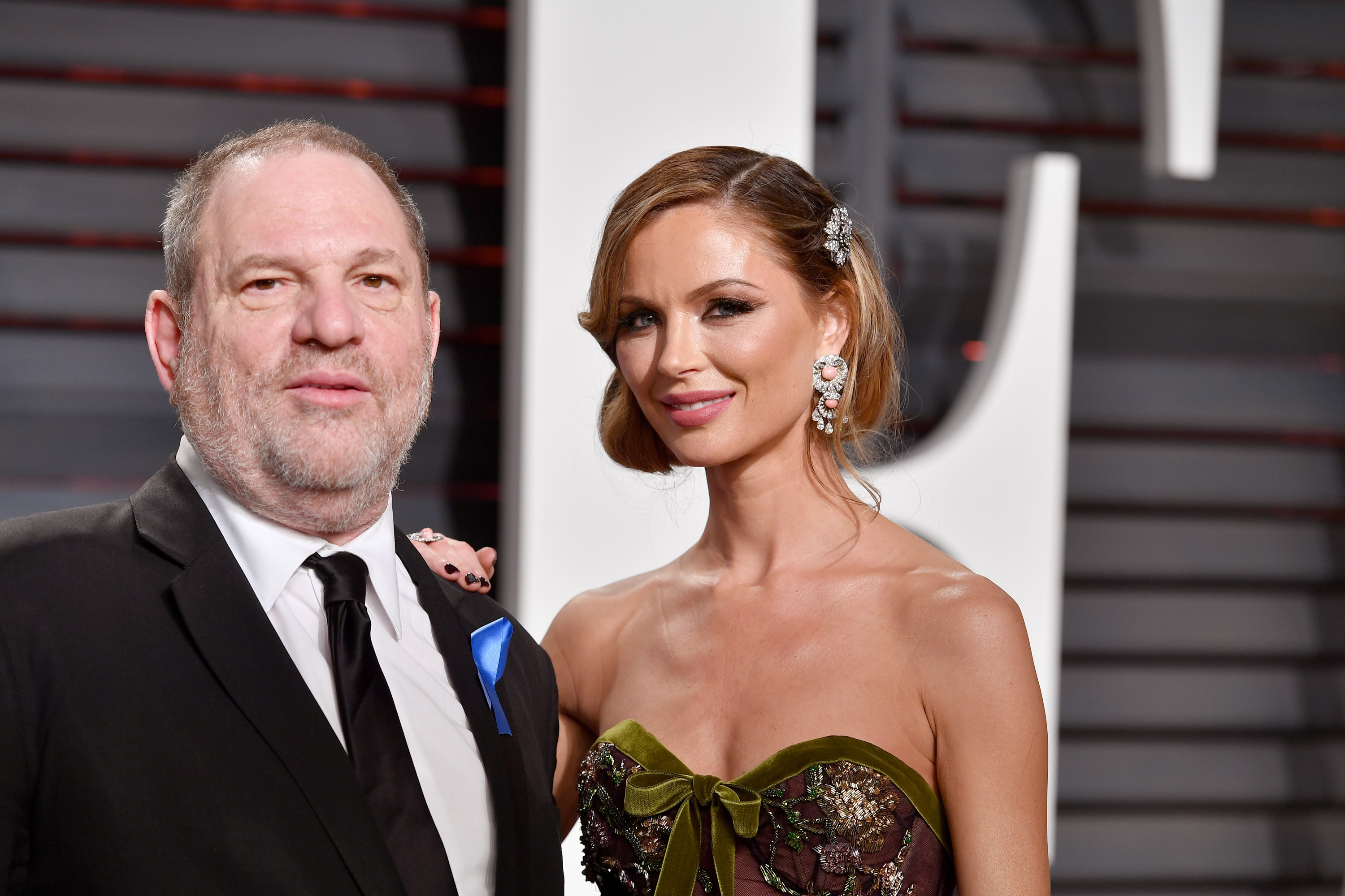 BEVERLY HILLS CA- FEBRUARY 26 Co-Chairman The Weinstein Company Harvey Weinstein and fashion designer Georgina Chapman attend the 2017 Vanity Fair Oscar Party hosted by Graydon Carter at Wallis Annenberg Center for the Performing Arts on February