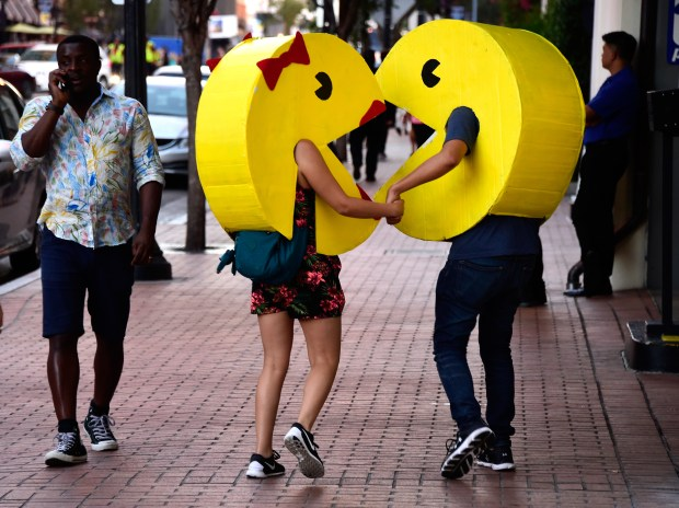 SAN DIEGO, CA - JULY 22: Pac-Man and Ms Pac-Man cosplayers attend Comic-Con International on July 22, 2016 in San Diego, California. (Photo by Frazer Harrison/Getty Images)