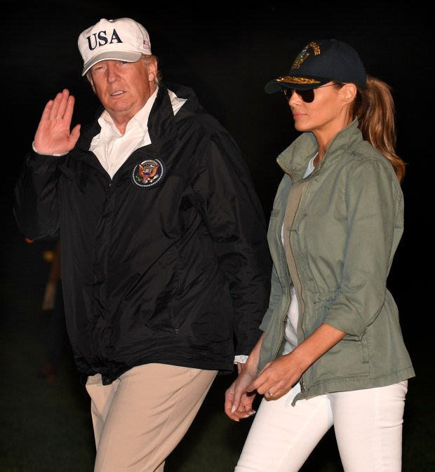 WASHINGTON, DC - OCTOBER 3: U.S. President Donald Trump and first lady Melania Trump return to the White House after a day trip to Puerto Rico where they viewed damage from Hurricane Irma October 3, 2017 in Washington, DC. (Photo by Mike Theiler-Pool/Getty Images)