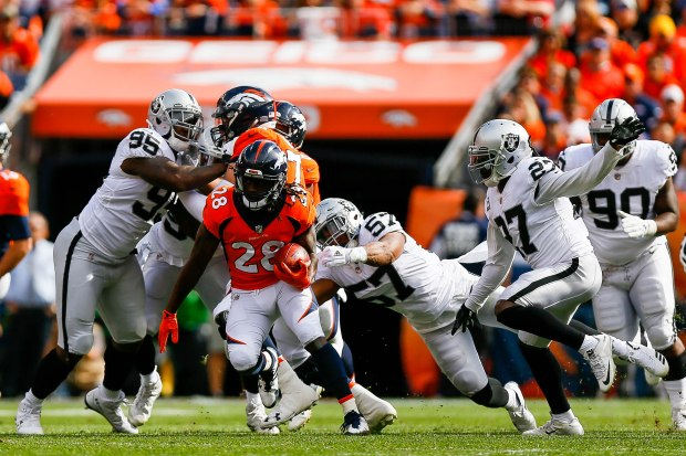 DENVER, CO - OCTOBER 1: Running back Jamaal Charles #28 of the Denver Broncos rushes against the Oakland Raiders in the second quarter of a game at Sports Authority Field at Mile High on October 1, 2017 in Denver, Colorado. (Photo by Justin Edmonds/Getty Images)