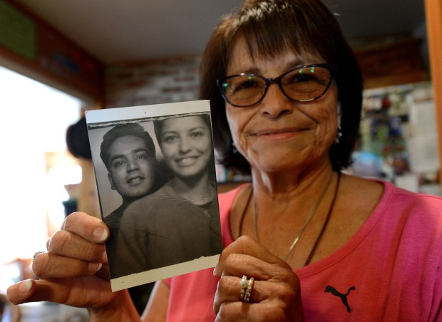 Sylvia Alvarez holds a photo of herself with her late husband Sal, taken in 1966, at her home in San Jose, Calif., on Friday, Oct. 6, 2017. Researchers at Stanford are in the early stages of archiving the work of the late Sal Alvarez, a Latino civil rights icon in San Jose who passed away in 2015. His family is donating over 100 boxes of personal items, documents and photos to continue his legacy and make these historical items accessible to the public. (Dan Honda/Bay Area News Group)