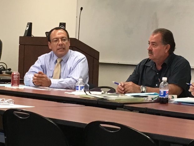 File photo shows Louie Moran, right, director of facilities, bonds andleases for the Alum Rock Union School District, and Lalo Trujillo, left, CEO of Mission Trail Financial Advisors, at an Alum Rock school board Bonds, Facilities and Finance Committee meeting May 19, 2017. (Sharon Noguchi/Bay Area News Group)