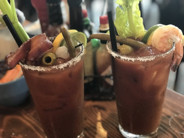 Burbank and Baltimore bloody marys, topped with bacon or shrimp and pickledvegetables are just two of the five brunch libations at The Breakfast Club in midtown San Jose. (Mary Orlin/Bay Area News Group)