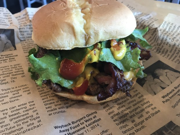 Wayback Burgers are served on a piece of Wayback newsprint.(Mary Orlin/Bay Area News Group)