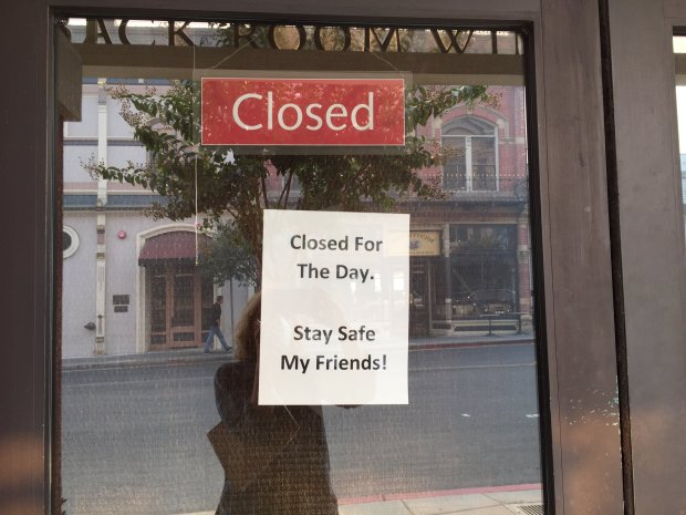 Many of the tasting rooms in downtown Napa were closed Wednesday, while ahandful opened for business despite the smoky air from the wildfires. (Angela Hill/Staff)