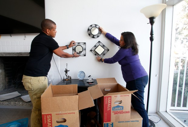 Troy and Maria Robinson unpack boxes as they settle into their new home, Sunday, October 29, 2017, in San Carlos, California. Maria, a school teacher, used the startup Landed that helps teachers qualify for Bay Area's affordable housing. (Karl Mondon/ Bay Area News Group)