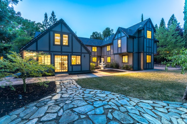 Stunning Tudor-style home nestled in the exclusive, gated Hidden Oaks neighborhood of Blackhawk.