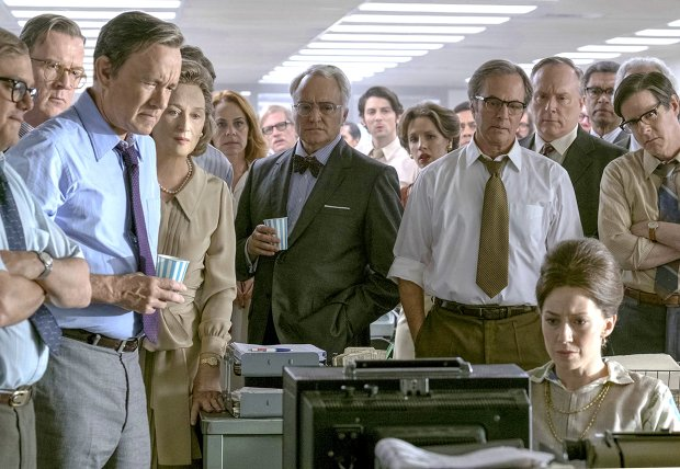 """The Post"" stars Tom Hanks as Ben Bradlee, second from left in front row,and Meryl Streep as Katharine Graham. (Niko Tavernise/Twentieth Century Fox)"