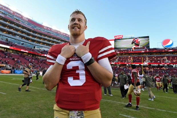 QUARTERBACK: San Francisco 49ers C.J. Beathard (3) is all smiles as he waits to be interviewed after defeating the New York Giants during their NFL game at Levi's Stadium in Santa Clara, Calif., on Sunday, Nov. 12, 2017. San Francisco defeated New York 31-21. (Jose Carlos Fajardo/Bay Area News Group)