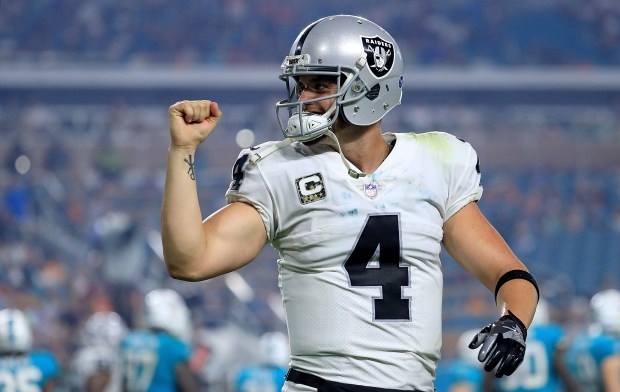 MIAMI GARDENS, FL - NOVEMBER 05:  Derek Carr #4 of the Oakland Raiders of the Oakland Raiders celebrates a touchdown during a game against the Miami Dolphins at Hard Rock Stadium on November 5, 2017 in Miami Gardens, Florida.  (Photo by Mike Ehrmann/Getty Images)
