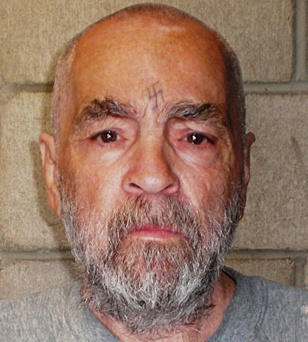 (FILES) This file of a handout photo released by the California State Prison, Corcoran, and taken on March 18, 2009 shows US mass murderer Charles Manson.HO/AFP/Getty Images