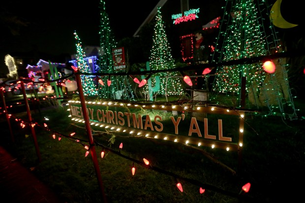 "Decorated houses are seen on Thompson Avenue, known as ""Christmas Tree Lane,"" in Alameda, Calif., on Tuesday, Dec. 13, 2016. Nearly 50 houses in the 3200 block are decorated in a tradition which began in 1938. The lights are lit from Saturday Dec. 3 through New Year's Eve. Santa will make a weather-permitting appearance every night from Dec. 9 - Dec. 23, from 6:30-8:00 p.m. (Jane Tyska/Bay Area News Group)"