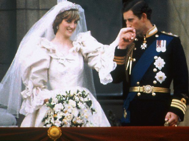 Prince Charles kisses the hand of his bride Princess Diana on the balcony of Buckingham Palace on their wedding day in London, England, July 29, 1981. (AP Photo/Press Association)