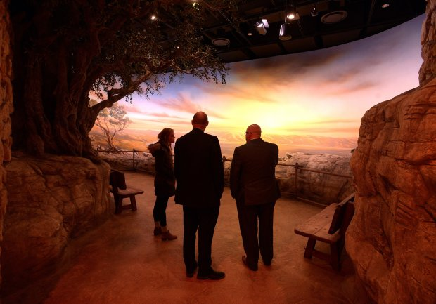 People stop to admire a diorama depicting the Sea of Galilee in the Worldof Jesus of Nazareth exhibit in the Museum of the Bible. MUST CREDIT: Photo for The Washington Post by Essdras M Suarez