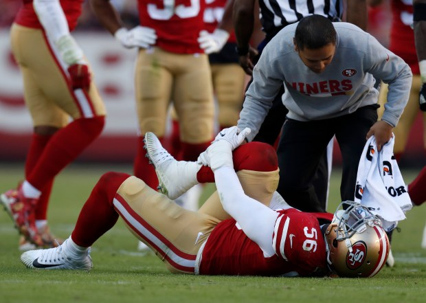 San Francisco 49ers' Reuben Foster (56) holds his leg during their game against the Arizona Cardinals in the third quarter of their NFL game at Levi's Stadium in Santa Clara, Calif. on Sunday, Nov. 5, 2017. (Nhat V. Meyer/Bay Area News Group)