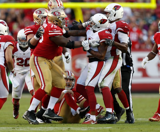 San Francisco 49ers' Laken Tomlinson (75) and Arizona Cardinals' Antoine Bethea (41) shove each other after a hard hit on San Francisco 49ers starting quarterback C.J. Beathard (3) in the fourth quarter of their NFL game at Levi's Stadium in Santa Clara, Calif. on Sunday, Nov. 5, 2017. (Nhat V. Meyer/Bay Area News Group)